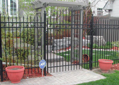 Wrought iron fence with trellis