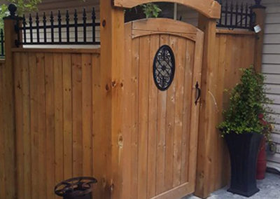 Cedar gateway with wrought iron top