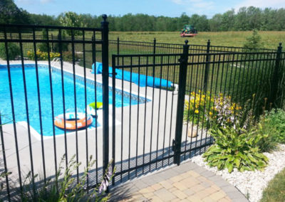 Wrought iron fence around pool